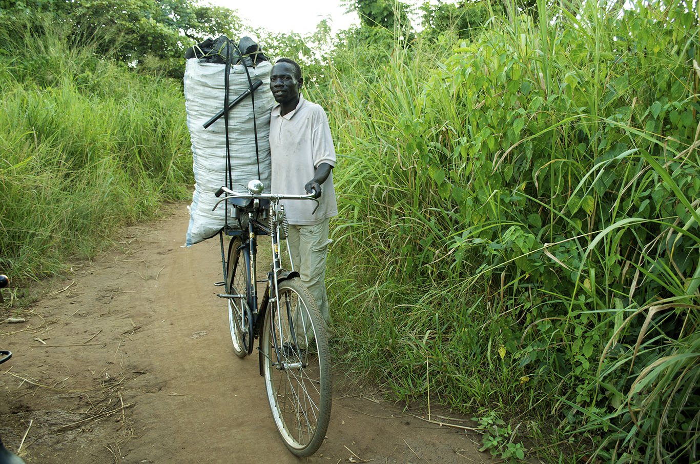 Man carrying cargo on a bicycle