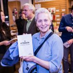 AFTERMATH Launch - Attendee holding the book