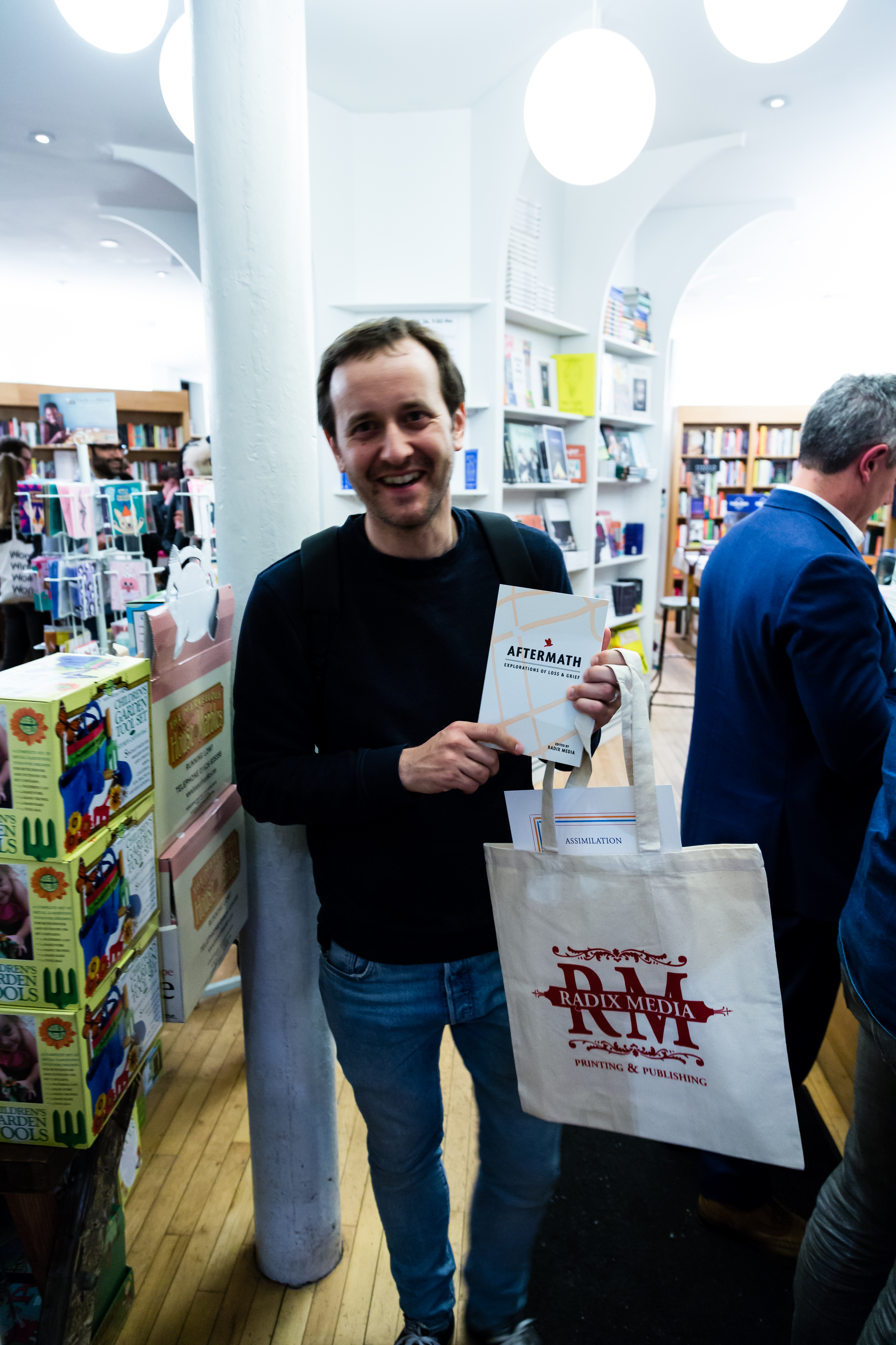 AFTERMATH Launch - Augustus holding a copy.