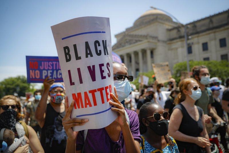 Radix Media Recap: Black Lives Matter, photo for AP by John Minchillo